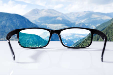 Close-up Of Mountains Seen Through Glasses On Sunny Day Фото со стока