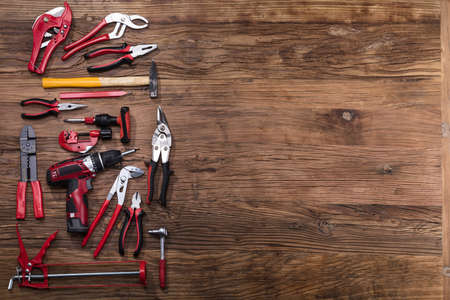 Elevated View Of Various Worktools On Wooden Desk