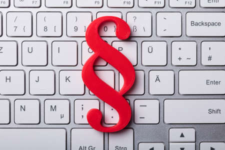 Elevated View Of Red Paragraph Symbol On Laptop Keypad