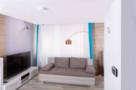 Interior Of Living Room With Sofa And Television