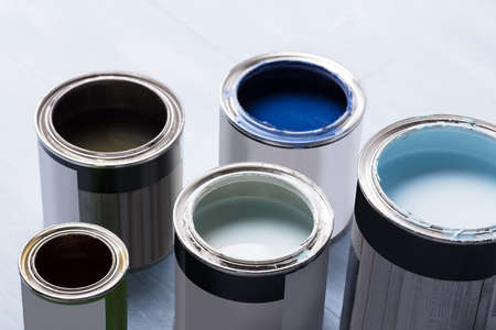 Photo Of Open Paint Cans On Wooden Plank