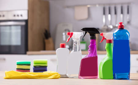 Close-up Of Cleaning Equipments And Gloves On Wooden Desk Zdjęcie Seryjne - 97150844
