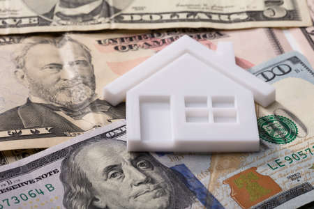 Close-up Of House Model With Red Roof On American Banknotes