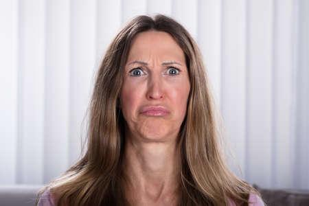 Close-up Of Sad Mature Woman At Home