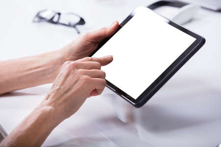 Womans Hand Using Digital Tablet With Blank White Screen