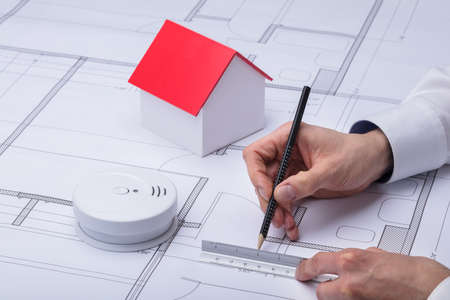 Architecture Drawing Blueprint Near Smoke Detector And House Model