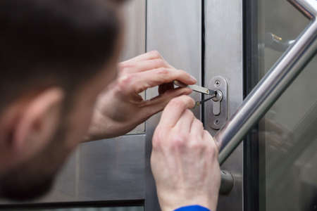 Close-up Of A Young Man Opening Door With Lockpicker