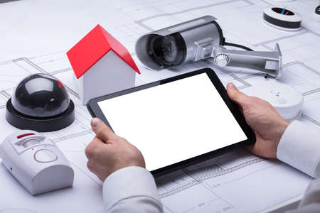 Architects Hand Using Digital Tablet With Blank White Screen Фото со стока