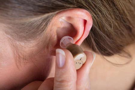 Close-up Photo Of Woman Wearing Hearing Aid Фото со стока