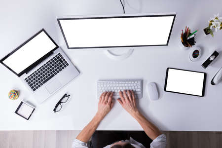 Businessperson Working On Computer With Blank White Screen