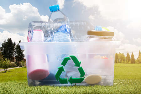 Close-up Of Water Bottles With Green Recycle Symbol On Container