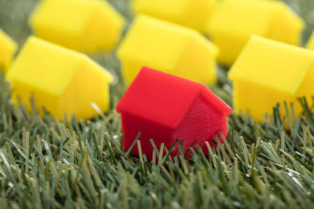Close-up Of A Red House Model On Green Grass