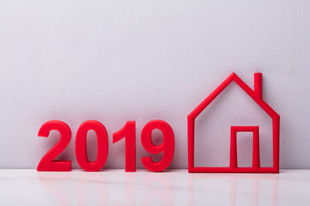 Year 2019 Near Outline Of Red House Against White Background Stock Photo