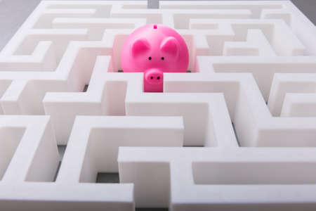 Close-up Of Pink Piggybank In The Centre Of White Maze Stock Photo - 103480525