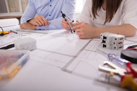 Two Architect Working With Work Tools Over Blueprint Foto de archivo - 103822315