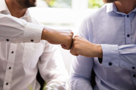 Close-up Of Two Business Partners Making Fist Bump