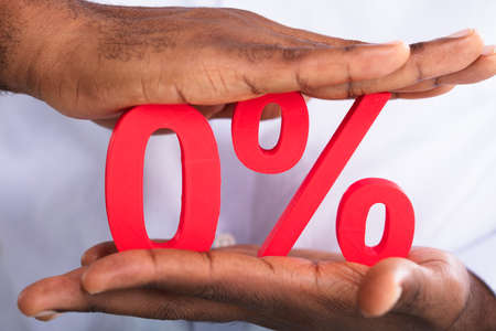 Two Hands Holding Red Zero Percentage Symbol