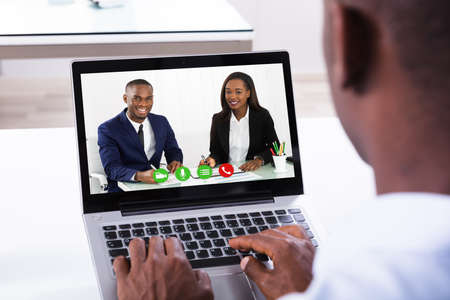 Close-up Of A Businessman Attending Video Conference On Laptop