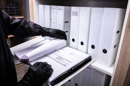 Thief With Black Gloves Holding Invoice Folder Standard-Bild - 106206730