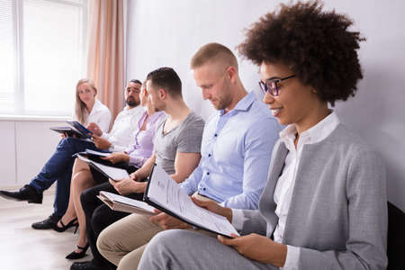 Group Of Diverse With Their Resume People Waiting For Job Interview