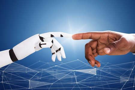Robot Touching Mans Index Finger Against Digital Backdrop