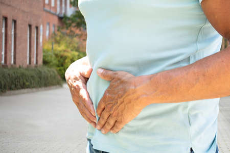 Midsection View Of A Man Having Stomachache Stock Photo