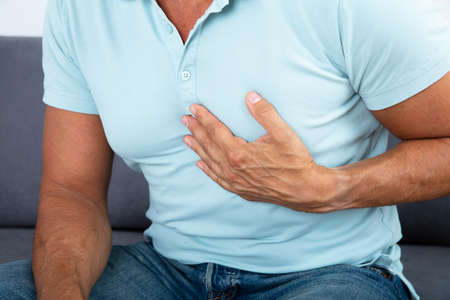 Close-up Of A Man With Chest Pain Suffering From Heart Attack