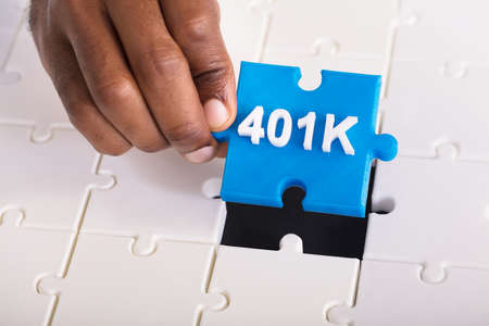 Overhead View Of A Persons Hand Holding 401k Blue Jigsaw Puzzle