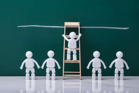 Human Figure Climbing Ladder To Reach Finish Line On Chalkboard Stok Fotoğraf
