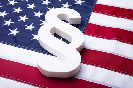 Close-up Of White Paragraph Symbol On American Flag Banco de Imagens