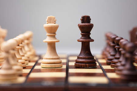 Brown And White King Chess Piece On Board Game Stock Photo