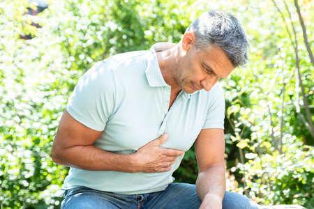 Portrait Of A Mature Man Having Heart Attack