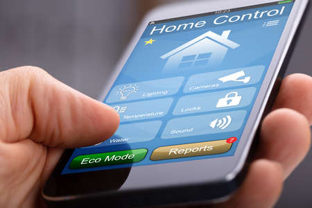 Person's Hand Holding Smart Phone With Home Control Application Standard-Bild - 108023939