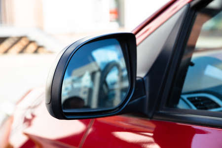 Rear View Mirror Of A Car Driving On Street Banco de Imagens - 109212310