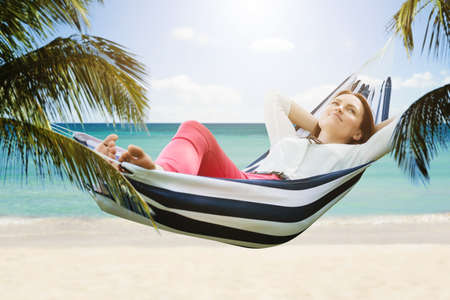 Close-up Of A Smiling Woman Relaxing In Hammock At Beach