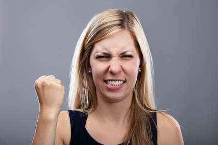 Photo Of Angry Young Woman On Grey Background