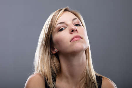 Portrait Of A Blonde Young Woman Showing Attitude