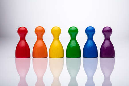 Row Of Colorful Pawns On Reflective Background Фото со стока