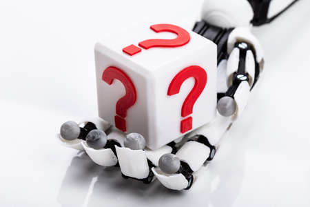 Robot Holding Cubic Block With Red Question Mark Sign On White Background