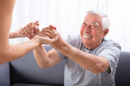 Close-up Of A Daughter Holding Hands Of Her Happy Father