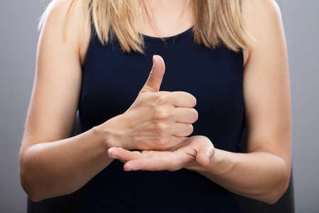 Close-up Of A Womans Hands Using Sign Language