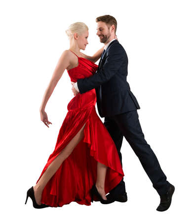Side View Of A Young Couple Dancing On White Background Фото со стока