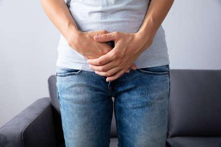 Midsection View Of A Woman Having Stomach Pain Фото со стока