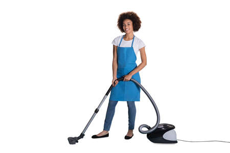 Portrait Of Happy Female Janitor With Vacuum Cleaner On White Background