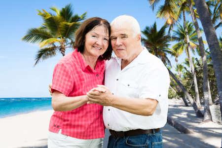 Portrait Of A Senior Couple Holding Hands Ta Beach