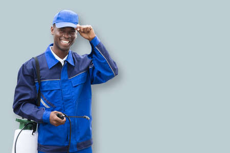 Portrait Of A African Male Pest Control Worker With Pesticide Sprayer