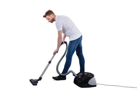 Man Using Vacuum Cleaner On White Background Banco de Imagens