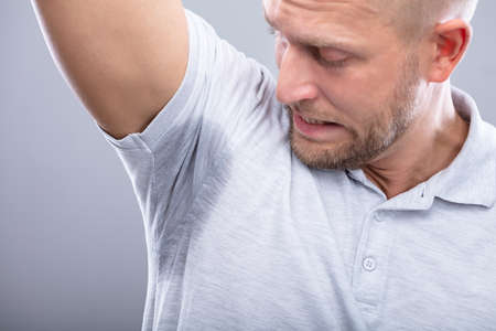 Close-up Of A Young Man Sweating Badly Under Armpit 版權商用圖片 - 113242594