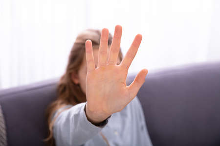 Close-up Of A Girl's Hand Showing Stop Sign