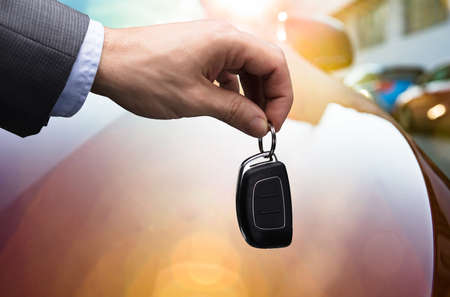 Close-up Of A Businessman's Hand Holding Car Key